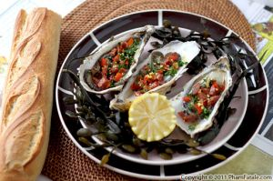 Fresh Oysters Topped with Chorizo Dressing
